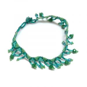 Handmade Czech glass seed bead and crystal bead anklet with tribal pattern design and beaded fringe dangles in turquoise blue, teal green, and mint color combination.