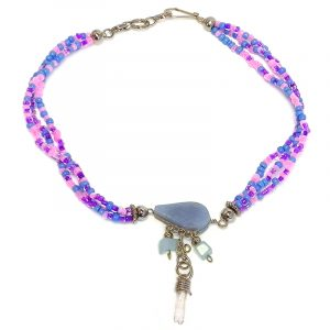 Handmade seed bead multi strand anklet with teardrop-cut angelite stone and natural clear quartz crystal and chip stone dangles in light blue, pink, and purple color combination.