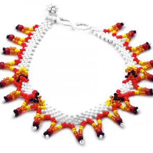 Handmade Native American inspired Czech glass seed bead anklet with V-shaped beaded fringe dangles in white and fire red, orange, yellow, and black color combination.