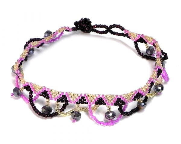 Handmade Czech glass seed bead and crystal bead anklet with tribal pattern design and beaded loop fringe dangles in pink, gold, and burgundy color combination.