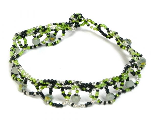 Handmade Czech glass seed bead and crystal bead anklet with multicolored pattern design and beaded loop fringe dangles in green, lime green, and silver color combination.