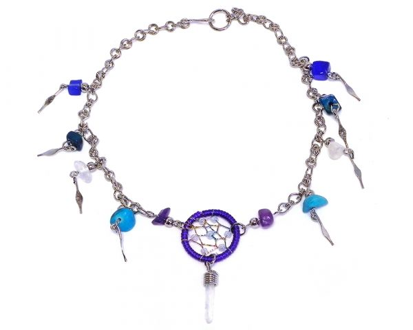 Handmade alpaca silver metal chain anklet with round beaded thread dream catcher, natural clear quartz crystal point, chip stones, and metal dangles in purple, white, blue, and turquoise color combination.