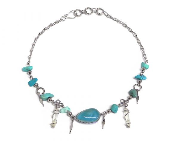 Handmade chip stone alpaca silver metal chain anklet with teardrop-shaped cat's eye glass bead, two wire wrapped natural clear quartz crystal points, and metal dangles in turquoise color.