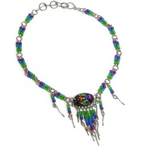 Handmade seed bead alpaca silver metal chain anklet with oval-shaped acrylic New Age themed chakra graphic design and long beaded metal dangles in green, turquoise blue, purple, and rainbow color combination.