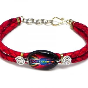 Handmade braided dyed leather bracelet with silver metal wire and oval-shaped acrylic New Age themed chakra graphic design centerpiece in red, black, and rainbow color combination.