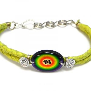 Handmade braided dyed leather bracelet with silver metal wire and oval-shaped acrylic New Age themed om sign graphic design centerpiece in yellow and rainbow color combination.