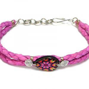 Handmade braided dyed leather bracelet with silver metal wire and teardrop-shaped acrylic New Age themed psychedelic mandala graphic design centerpiece in pink, hot pink, black, and lime green color combination.
