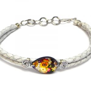 Handmade braided dyed leather bracelet with silver metal wire and teardrop-shaped acrylic vintage themed sunflower floral pattern graphic design centerpiece in white, golden yellow, and multicolored color combination.
