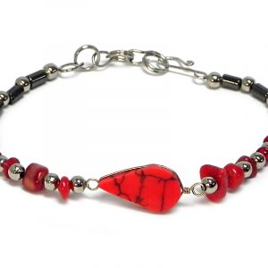 Handmade hematite, chip stone, and silver metal seed bead bracelet with teardrop-cut gemstone cabochon centerpiece in red howlite.