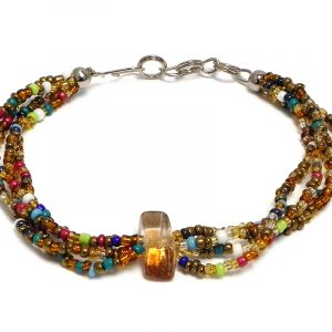 Handmade multicolored seed bead multi strand bracelet with tumbled chip stone centerpiece in brown, gold, and multicolored color combination.