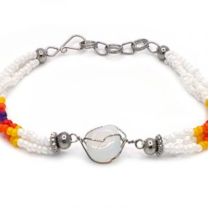 Handmade Native American inspired multicolored seed bead multi strand bracelet with silver metal wire wrapped tumbled iridescent opalite gemstone crystal centerpiece in white, yellow, orange, red, and dark purple color combination.