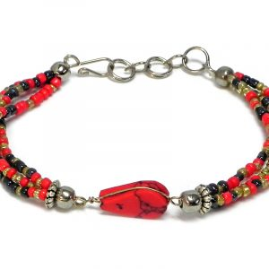Handmade multicolored seed bead multi strand bracelet with teardrop-cut red howlite gemstone crystal cabochon centerpiece in red, gold, and dark gray charcoal color combination.