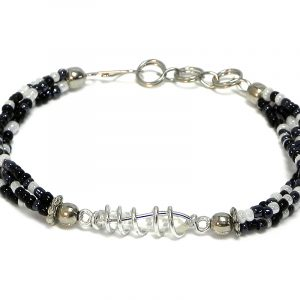 Handmade multicolored seed bead multi strand bracelet with silver metal wire wrapped clear quartz crystal centerpiece in black, dark gray charcoal, and white color combination.