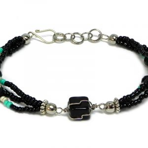 Handmade seed bead and crystal bead multi strand bracelet with silver metal wire wrapped tumbled black onyx gemstone crystal centerpiece in black, mint green, and pearl white color combination.