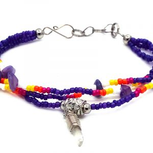 Handmade Native American inspired chip stone and multicolored seed bead multi strand bracelet with silver metal wire wrapped clear quartz crystal point dangle in dark purple, dark pink, orange, yellow, and white color combination.