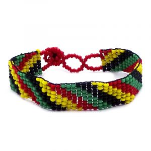 Handmade Czech glass seed bead thin strap bracelet with matte slanted striped pattern design in Rasta colors.
