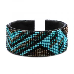 Handmade Czech glass seed bead black leather cuff bracelet with tribal triangle pattern design in turquoise mint, teal green, brown, and black color combination.