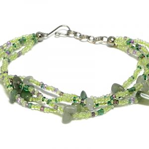 Handmade seed bead multi strand bracelet with chip stones in light green, green, and lavender, and dark gray color combination.
