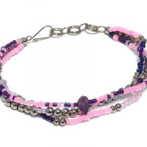 Handmade seed bead and silver metal bead multi strand bracelet with chip stones in pink, dark purple, and light pink color combination.