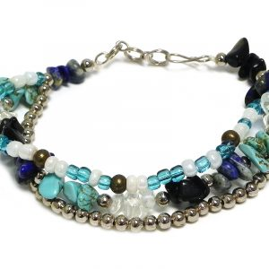 Handmade chip stone, large seed bead, and silver metal bead thick multi strand bracelet in turquoise, blue, black, white, and clear color combination.