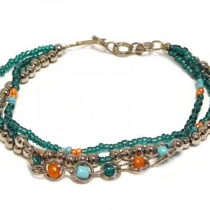 Handmade seed bead and silver metal bead multi strand bracelet with beaded chain link loop centerpiece in teal green, orange, and turquoise mint color combination.