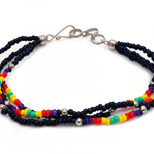 Handmade Native American inspired seed bead multi strand bracelet in black, dark purple, red, yellow, and mint green color combination.