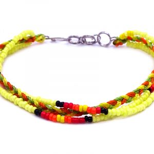 Handmade Native American inspired seed bead and macramé braided string multi strand bracelet in yellow, lime green, orange, black, and red color combination.