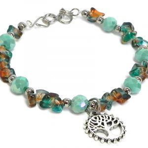 Handmade crystal bead and chip stone bracelet with round silver metal tree of life charm dangle in mint green and tie dye teal and orange color combination.