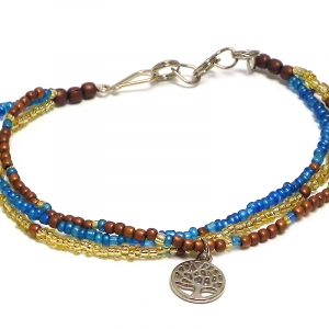 Handmade seed bead multi strand bracelet with round silver metal tree of life charm dangle in turquoise blue, gold, and brown color combination.