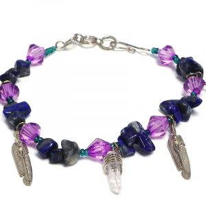 Handmade crystal bead, seed bead, and chip stone bracelet with clear quartz crystal and two silver metal feather charm dangles in blue sodalite and purple color combination.