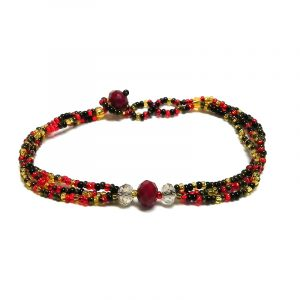 Handmade Czech glass seed bead multi strand bracelet with triple crystal bead centerpiece in red, gold, dark brown, and black color combination.