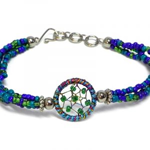 Handmade multicolored seed bead multi strand bracelet with round beaded sparkle thread dream catcher centerpiece in teal, turquoise blue, green, and indigo color combination.