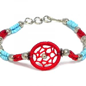 Handmade multicolored seed bead and silver metal bead rope-like bracelet with round thread dream catcher centerpiece in red, light blue, and clear silver color combination.