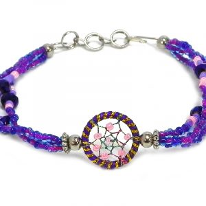 Handmade seed bead and crystal bead multi strand bracelet with round beaded sparkle thread dream catcher centerpiece in purple, gold, dark purple, and light pink color combination.