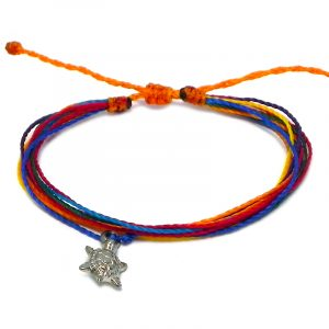 Handmade multistrand string pull tie bracelet with silver metal sea turtle charm dangle in rainbow colors.