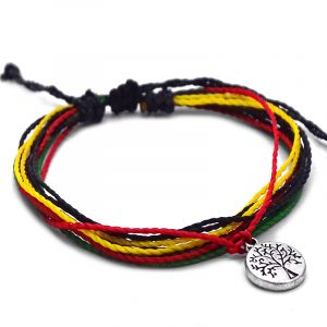 Handmade multicolored multi strand string pull tie bracelet with round silver metal tree of life charm dangle in Rasta colors.