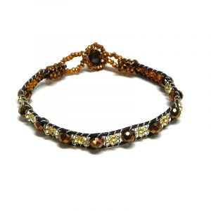 Handmade Czech glass seed bead and crystal bead thin strap bracelet in brown, dark brown, and gold color combination.
