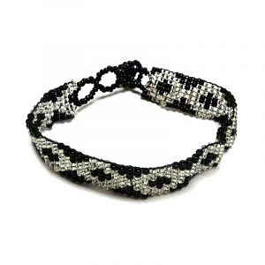 Handmade Czech glass seed bead thin strap bracelet with diamond pattern design in black and white silver color combination.