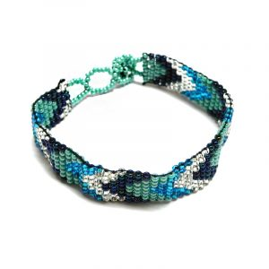 Handmade Czech glass seed bead thin strap bracelet with chevron striped pattern design in turquoise blue, mint, navy, and silver color combination.
