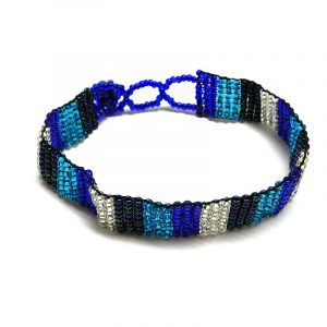 Handmade Czech glass seed bead thin strap bracelet with striped pattern design in blue, navy, turquoise, and silver color combination.