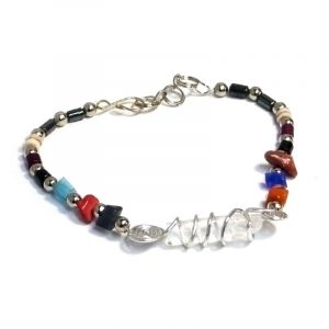 Hematite, multicolored chip stone, and silver metal seed bead bracelet with wire wrapped clear quartz crystal centerpiece.