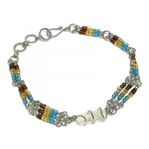 Handmade multicolored seed bead silver metal chain bracelet with wire wrapped clear quartz crystal centerpiece in turquoise blue, gold, and brown color combination.