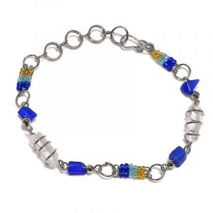 Handmade double wire wrapped clear quartz crystal, chip stone and multicolored seed bead silver metal chain bracelet in blue, light blue turquoise, and gold color combination.