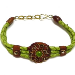 Handmade braided dyed leather bracelet with brown resin, gold-colored metal wire flower design, and single bead centerpiece in lime green color.