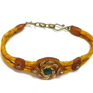 Handmade braided dyed leather bracelet with brown resin, mixed metal spiral design, and mini round teal green chrysocolla stone cabochon centerpiece in golden yellow-orange color.