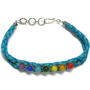 Handmade braided dyed leather bracelet with 7 chakra rainbow-colored beaded centerpiece in turquoise color.