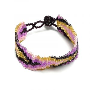 Handmade Czech glass seed bead wide strap bracelet with arrow pattern design in pink, light pink, burgundy, and gold color combination.