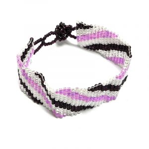 Handmade Czech glass seed bead wide strap bracelet with slanted striped pattern design in pink, white, burgundy, and silver color combination.
