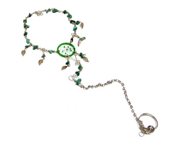 Handmade alpaca silver metal chain harem anklet with round beaded dream catcher, chip stones, and metal leaf charm dangles, linked to toe ring in green color.