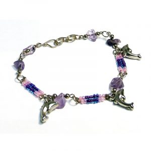 Handmade seed bead and chip stone alpaca silver metal chain bracelet with three dolphin charm dangles in light pink, lavender, and purple color combination.